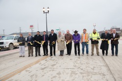Joel Wilt (Williston District Engineer), Senator Brad Bekkedahl, Scott Davis (Indian Affair Commisioner) Grant Levi (NDDOT Director) Ken Hall (Tribal Chairman), Governor Jack Dalrymple, Senator John M. Warner, Mayor Dan Uran (New Town), contractor, contractor, Alan Esvold & Representative Kenton Onstad gather to cut the Ribbon commemorating the completion of the $20 million New Town Main Street reconstruction project
