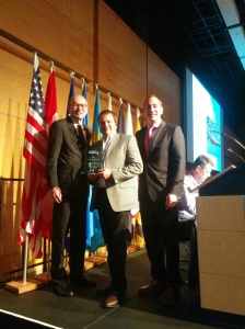 Maine DOT' Director David Bernhardt and AASHTO Vice President accepts the award for his state's project.