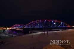 The Sorlie Bridge that spans the Red River between Grand Forks and East Grand Forks, MN has had LED lighting added to it. The lights are controlled by a computerized device which is placed inside the pumphouse next to the river near the bridge. The color of the lights can be changed easily and several preprogramed color schemes are coordinated with holidays and special events.